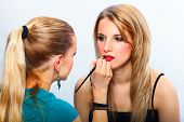 Make-up Artist Applying Lipstick On Model's Lips