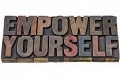 empower yourself - motivation concept - isolated text in vintage letterpress wood type blocks staine