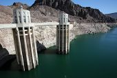 HOOVER DAM, NEVADA - SAT. JUNE 28, 2014: Dry, white cliffs show the severely reduced water level of