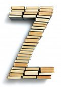 Letter Z formed from the page ends of closed vintage hardcover books standing on a white background