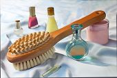 Massage brush for massage of a body and cosmetics for care of a body.
