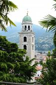 LUGANO, SWITZERLAND - JULY 6, 2014: The Cathedral of Saint Lawrence Bell Tower. The tower is in the