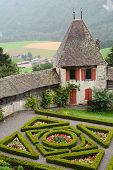 GRUYERES, SWITZERLAND - JULY 8, 2014: Gruyeres Castle Gardens and Ramparts. Located in the medieval
