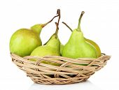 Pears in basket, isolated on white