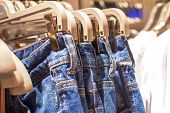 Jeans Hanging On A Hanger In The Store