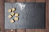 Caramels And Sugar On Slate Plate