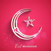 Arabic islamic calligraphy of silver text Eid Mubarak in crescent moon and star shape on pink backgr