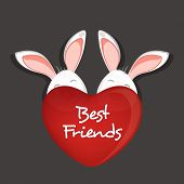 Happy Friendship Day celebrations concept with cute bunnies hiding behind red heart shape on grey ba