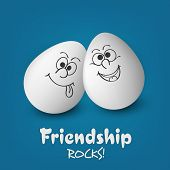 Happy Friendship Day celebrations concept with smiley faces painted on white eggs on blue background