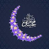 Arabic islamic calligraphy of text Eid Mubarak with crescent moon on blue background for muslim comm