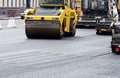 Asphalt Paving Works With Road Rollers