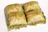 image of baklava  - Turkish dessert Pakhlava or Baklava Isolated On White - JPG