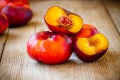Fresh Flat Nectarines On A Wooden Background