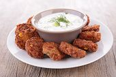 yogurt sauce and falafel