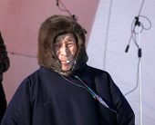 Nadym, Russia - March 15, 2008: Unknown Man Nenets On The Stage And Smokes.