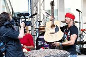 NEW YORK-JUL 18: Singer Bret Michaels autographs a guitar at Fox and Friends' All-American Summer Co