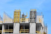stock photo of formwork  - Concrete formwork with a folding mechanism on construction site - JPG