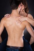 image of intimate  - Rear view of young man carrying woman while getting intimate isolated over white background - JPG