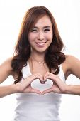 Beautiful Smiling Girl Holding Hands In Heart Shape Framing.