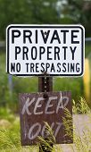 Weathered No Trespassing Sign