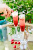 Summer Cocktail With Champagne And Fresh Raspberries