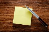 Blank Yellow Notepad And Pen On Table