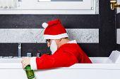 Drunk Santa Claus Sleeping In The Bathtub