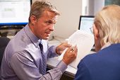 Doctor Discussing Test Results With Senior Male Patient