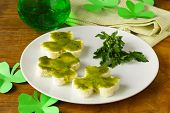 funny sandwiches in the form of clover with green cheese Patrick's Day food