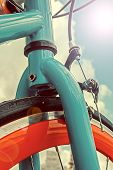 Vintage Look At One Bicycle In Lens Flare Reflection