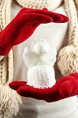 Knitted Christmas angel in female hand, close-up