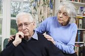 Woman Comforting Senior Man With Depression