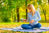Pregnant Girl Reading Notes In A Notebook Is Preparing To Childbirth