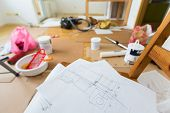 foto of interior sketch  - Drawing of home renovation in room full of painting tools - JPG