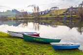 ZAWOZ, POLAND, NOVEMBER 09, 2014: Fishing boats moore on shore of Solina Lake in Bieszczady