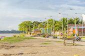 RURRENABAQUE, BOLIVIA, MAY 10, 2014 - Riverbank promenade (Beni river shore) with benches