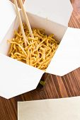 fast food. chinese noodles in paper box