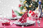 holidays, celebration and home concept - close up of room with christmas tree and decorated table