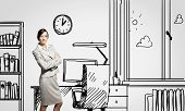 Young confident businesswoman standing in drawn office