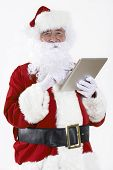 Santa Claus Using Digital Tablet On White Background