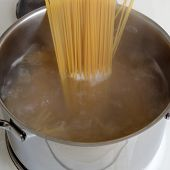 Preparing Spaghetti Pasta Meal Cooking Noodles In Water In Pot