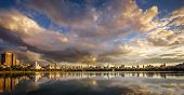 Постер, плакат: Sunset over Central Park Reservoir and Manhattan New York