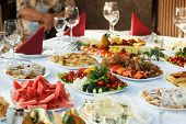 picture of banquet  - Festive banquet table with celebrate delicious food - JPG