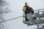 SOCHI, RUSSIA - DECEMBER 12, 2013: Workers repairing the ski lift in mountain resort