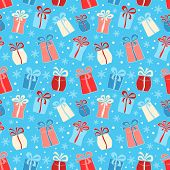 Seamless Pattern With Color Gifts And Snowflakes
