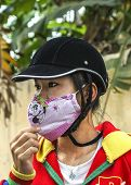 Young Vietnamese Women With Face Covering Mask.