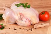 foto of marinade  - Raw chicken on wooden table - JPG