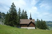 Old Wooden Chapel In Mountains.