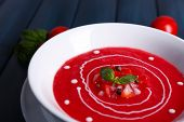 Gazpacho soup on color wooden background