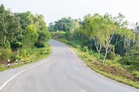 stock photo of twisty  - Unsecured twisty road mountain in rural  - JPG